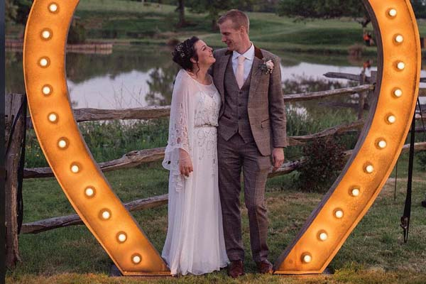 Kent wedding couple under light up heart