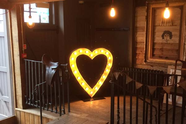 light up heart in barn wedding