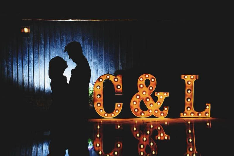light up intials - with silhouette bride and groom