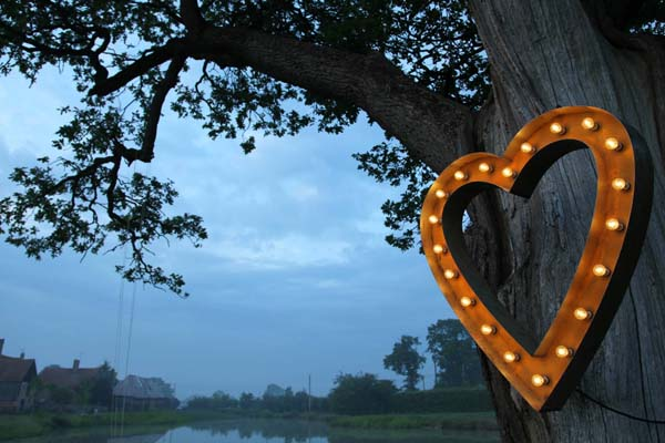 light up marquee letter heart in tree