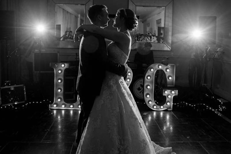 wedding couple in silhouette with light up letters
